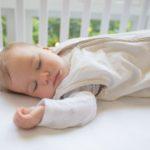 Baby sleeping in Joey Swag baby sleeping bag