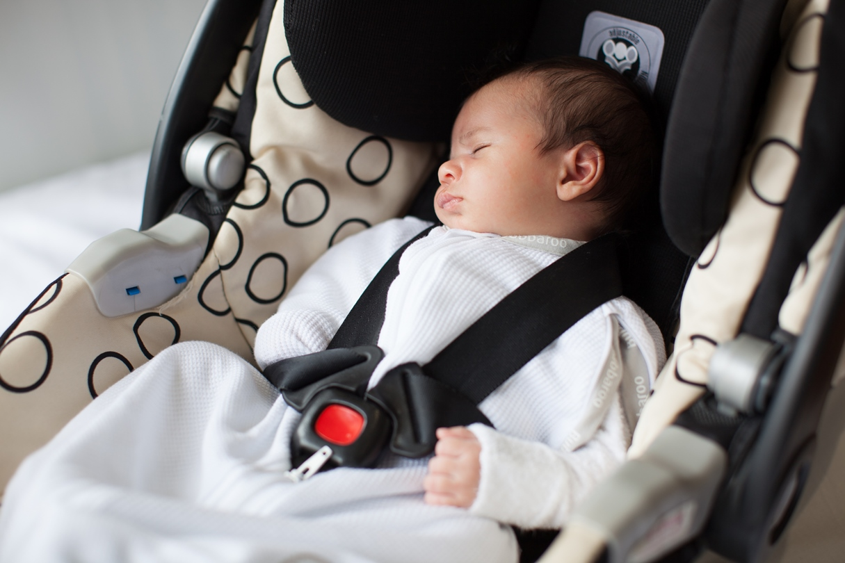 Transitional Swaddle used in a baby capsule