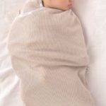 Emily asleep in Joey Pouch Swaddle